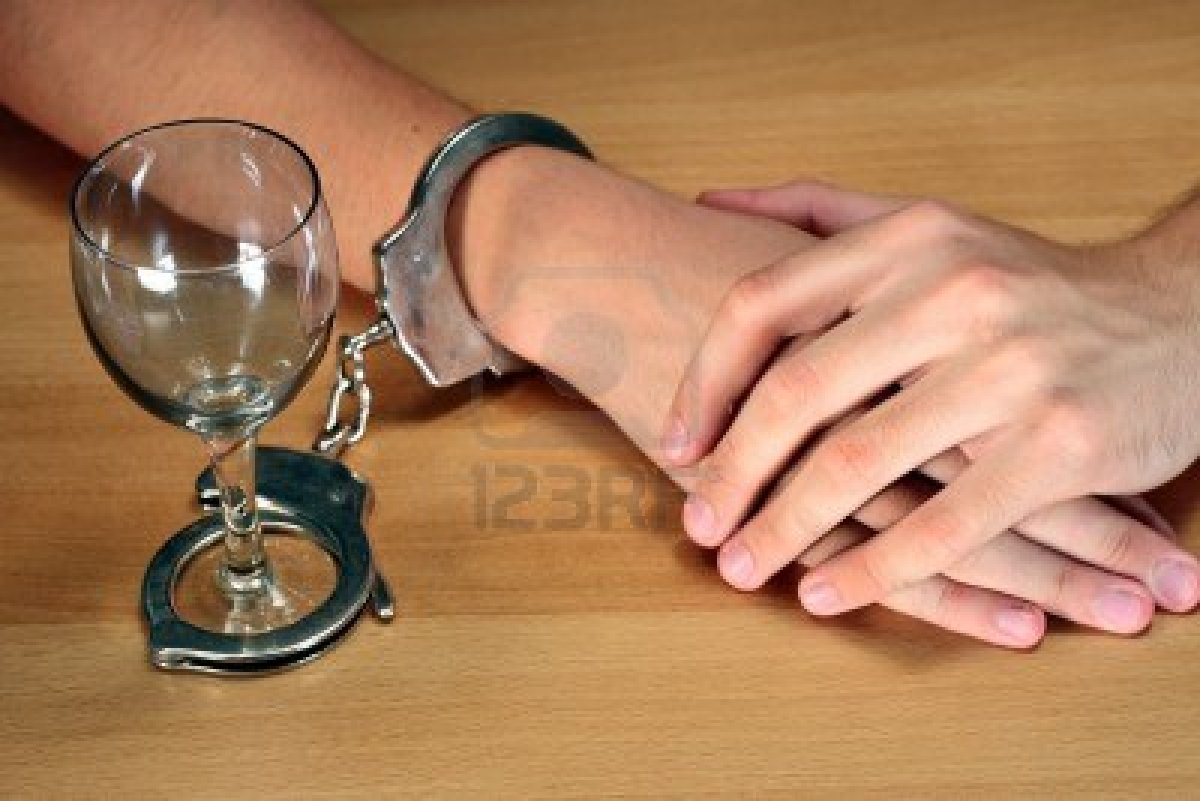 1929606-alcohol-addiction-hands-handcuffed-with-an-empty-alcohol-glass
